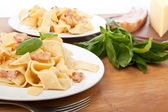 Two servings of homemade pasta carbonara with fresh basil — Foto Stock