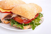 Ciabatta bread sandwiches stuffed meat,cheese and vegetables — Stock Photo