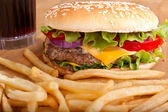 Cheeseburger with fries and a drink — Stock Photo