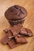 Chocolate muffin with pieces of chocolate — Stock Photo