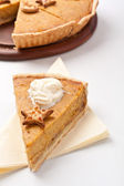 Pumpkin pie with whipped cream — Stock Photo