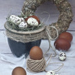 Brown and guinea fowl eggs in a pot and brown and guinea fowl eggs laid on the floor — Stock Photo #43397909
