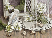 Easter ,eggs in a cage, spring white flowers, quail eggs, white bunnies — Stock Photo