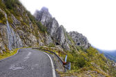 Autumn, mountain road and tunnels in Italy. — Stock Photo