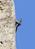 Happy woman climbing rock, active holidays. — Foto Stock