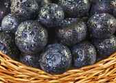 Fresh blueberries with water drops in wicker basket. — Photo