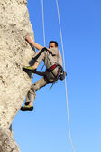 Difficult rock climbing position on horizontal cliff, mountains  — Stock Photo