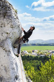 Man climbing natural rocky wall with beautiful view. — Stock Photo