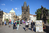 Tourists, street artists and vendors on Charles Bridge, one of the most famous place in the city. — Stock Photo