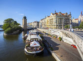 Restaurant on boat at the pier of Vltava river in old town of Prague. — Stock Photo