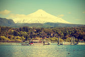 Snow covered Volcano Villarica, Chile, vintage retro style.  — Stock Photo