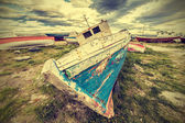 Old boat wreck, vintage retro style.  — Stock Photo