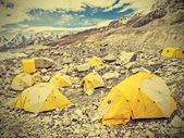 Tents in Everest Base Camp in cloudy day, Nepal, vintage retro — Stock Photo