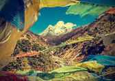 Prayers flags in Himalaya mountains, Nepal, vintage retro style. — Stock Photo
