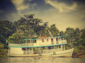 Wooden boat on the Amazon river, Brazil, vintage retro instagram — Stock Photo