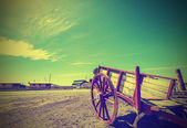 Old cart left on deserted road in Patagonia, vintage retro effec — Stock Photo