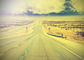 Endless country highway, vintage retro effect. — Stock Photo