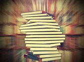 Books on blured bookshelf background, vintage style. — Stock Photo