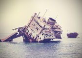 The sunken shipwreck on the reef, Egypt, vintage retro filtered. — Zdjęcie stockowe