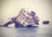 The sunken shipwreck on the reef, Egypt, vintage retro filtered. — ストック写真