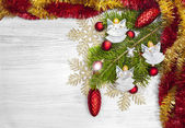 Christmas background with angels, decoration on a wooden board. — Stock Photo