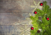 Christmas background, decoration on a rustic wooden board. — ストック写真