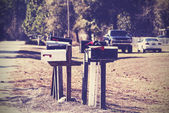 Vintage picture of mail boxes, rural area, USA.  — Stock Photo