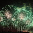 Green and golden firework — Stock Photo