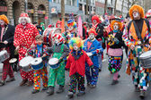 Group of people in front of the carnival procession — Stock Photo