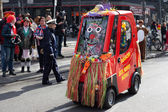 A small electric car at a carnival procession — Stock Photo