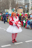 Women dressed as a clown at  carnival procession — Stock Photo