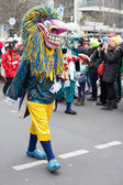 Person wearing carnival costume and walking in carnival parade — Stock Photo
