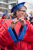 Women plays a transversal flute at a carnival parade in Cologne, — Stock Photo