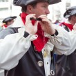 Stock Photo: Focused flutist walking at carnival parade