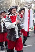 Focused musicians walking at a carnival parade — Stock Photo