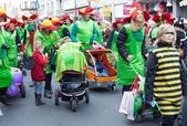 Group of women, children and men walking in carnival parade — Stock Photo