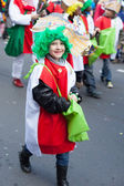 Laughing child in carnival parade — Stock Photo