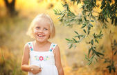 Cute little girl walks in the olive grove — Stock Photo