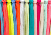 Colorful scarves at a market in Italy. Colors of textiles — Stock Photo