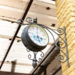 Old clock on the golden brick wall. — Stock Photo #51046225