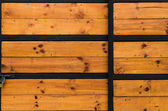 Weathered old barn wood door with vintage iron hinges on an anti — Stock Photo