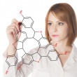 Stock Photo: Chemist drawing organic formula