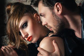Fashion photo of sexy elegant couple in the tender passion — Stock Photo