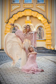 Two girls on the street, the wicked witch — Стоковое фото