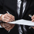 Extreme close up of female business hand signing document. — Foto Stock