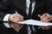 Extreme close up of female business hand signing document. — Stock Photo