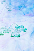 Color inks in water — Stock Photo