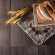 Freshly baked traditional bread on wooden table — Stock Photo #51120451