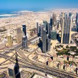 Dubai, UAE. Aerial view of Downtown Dubai Girl made lake and skyscrapers of the tallest building in the world, Burj Khalifa — Stock Photo
