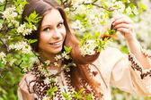 Portrait of a beautiful spring girl in cherry tree flowers. — Stock Photo